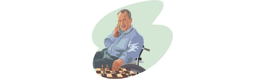 man talks on telephone while playing chess